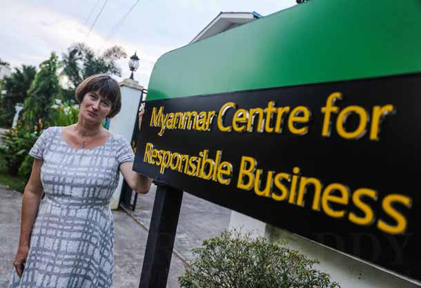 Vicky Bowman, director of the Myanmar Center for Responsible Business, stands outside the Myanmar Centre for Responsible Business in Rangoon. (Photo: JPaing / The Irrawaddy)